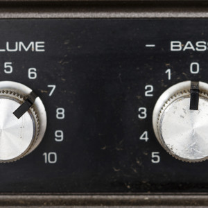 Volume and bass adjustment dials on a stereo