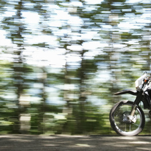 Motor bike speeding through the woods