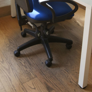desk and chair on hard surface floor